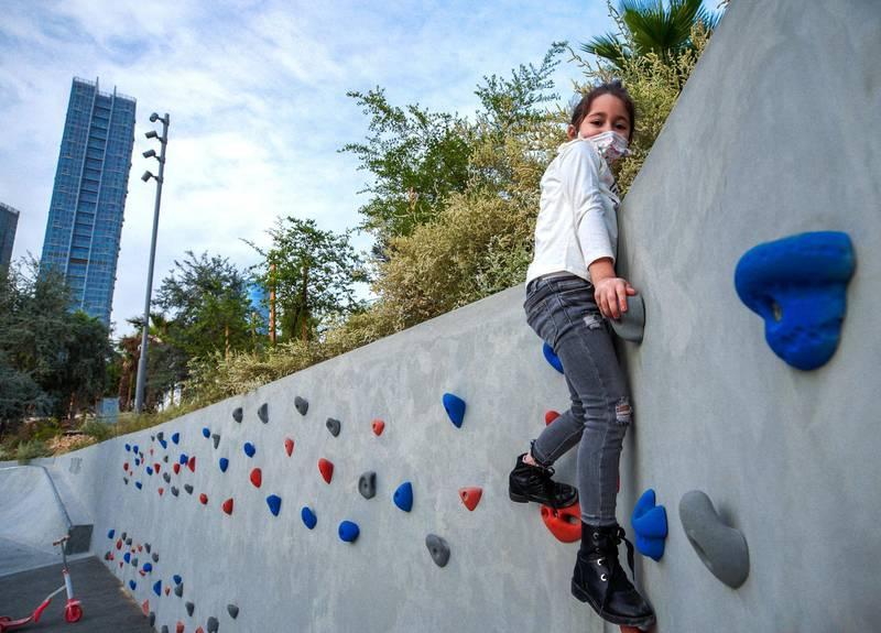 Abu Dhabi, United Arab Emirates, January 21, 2021.  Maria Agha, 6, practices wall climbing at Al Fay Park on Reem Island.Victor Besa/The National Section:  LFReporter: Panna Munyal