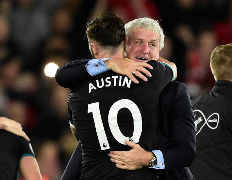 """Soccer Football - Premier League - Swansea City v Southampton - Liberty Stadium, Swansea, Britain - May 8, 2018   Southampton manager Mark Hughes and Charlie Austin celebrate after the match     REUTERS/Rebecca Naden    EDITORIAL USE ONLY. No use with unauthorized audio, video, data, fixture lists, club/league logos or """"live"""" services. Online in-match use limited to 75 images, no video emulation. No use in betting, games or single club/league/player publications.  Please contact your account representative for further details."""