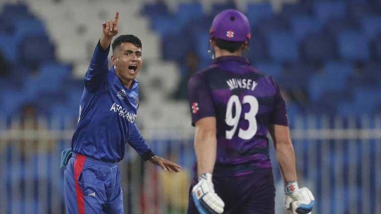 An image that illustrates this article T20 World Cup: Mujeeb takes five as Afghanistan demolish Scotland