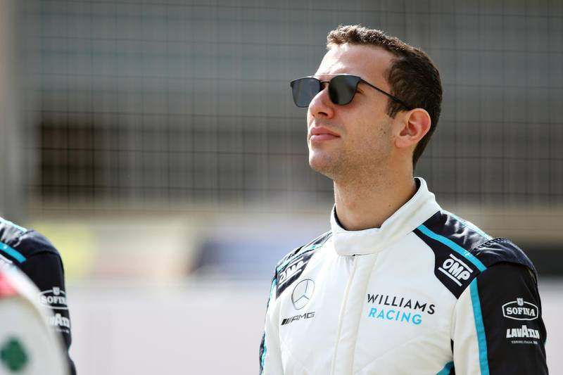 BAHRAIN, BAHRAIN - MARCH 12: Nicholas Latifi of Canada and Williams looks on from the grid during Day One of F1 Testing at Bahrain International Circuit on March 12, 2021 in Bahrain, Bahrain. (Photo by Joe Portlock/Getty Images)