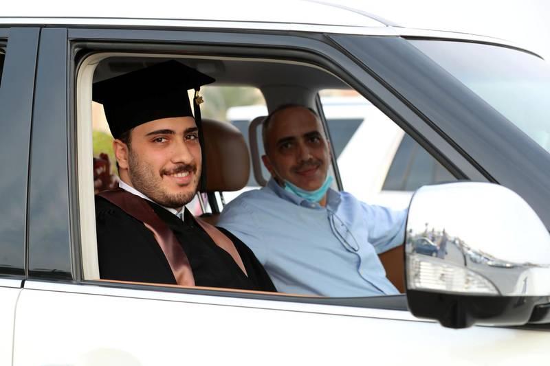 Ajman, United Arab Emirates - Reporter: Anam Rizvi. News. Eyad Al Keddah waits in his car before his drive through graduation from Ajman University because of Covid-19. Wednesday, February 10th, 2021. Ajman. Chris Whiteoak / The National