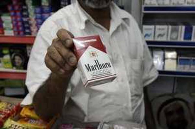 United Arab Emirates - Abu Dhabi - Jan 06 - 2010 : A seller show a Malboro Cigarette pack in a shop. ( Jaime Puebla / The National ) *** Local Caption ***  JP Smoking 04c.jpg