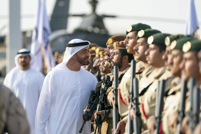 SWEIHAN, ABU DHABI, UNITED ARAB EMIRATES - February 09, 2020: HH Sheikh Mohamed bin Zayed Al Nahyan, Crown Prince of Abu Dhabi and Deputy Supreme Commander of the UAE Armed Forces (C), inspects military personnel during a reception at Zayed Military City to celebrate and honor members of the UAE Armed Forces who participated in the Arab coalition in Yemen.  ( Ryan Carter / Ministry of Presidential Affairs ) ---