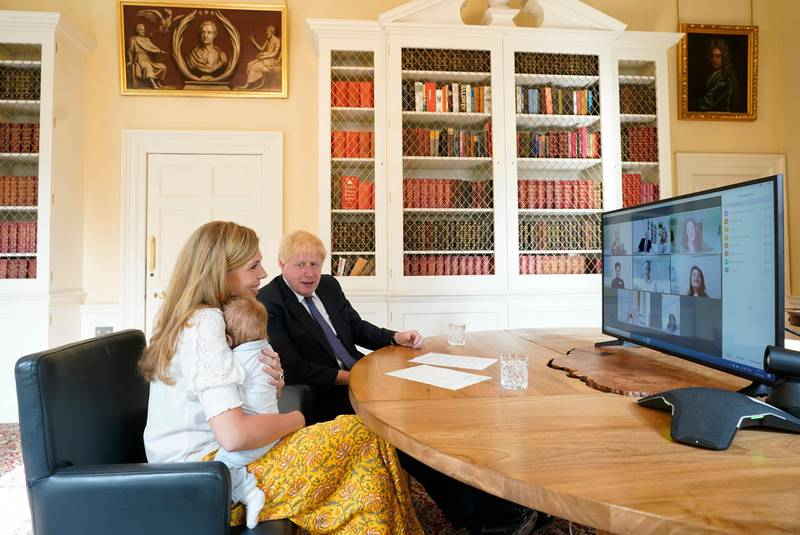 Embargoed until 2200 18072020….14/07/2020. London, United Kingdom. Boris Johnson and Carrie NHS Call.The Prime Minister Boris Johnson and his partner Carrie Symonds with their son Wilfred in the study of No10 Downing Street speaking via zoom to the midwifes that helped deliver their son at the UCLH. Picture by Andrew Parsons / No 10 Downing Street