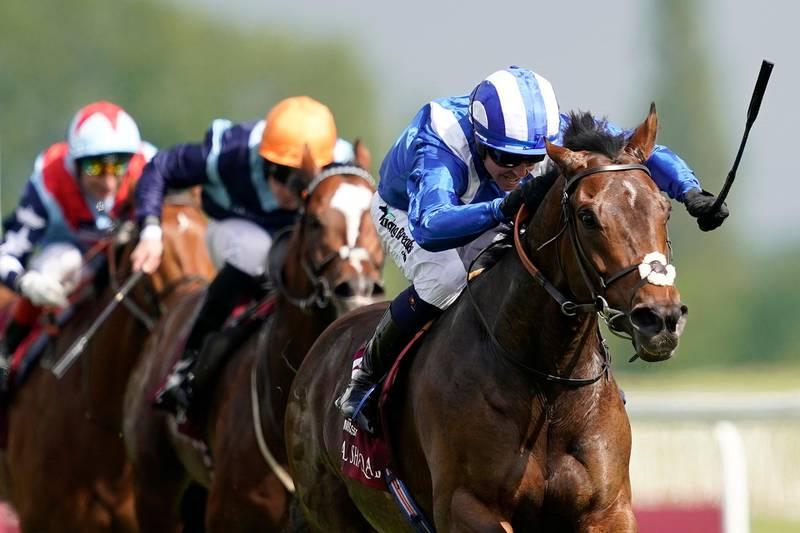 NEWBURY, ENGLAND - MAY 18: Jim Crowley riding Mustashry (blue) win The Al Shaqab Lockinge Stakes at Newbury Racecourse on May 18, 2019 in Newbury, England. (Photo by Alan Crowhurst/Getty Images)