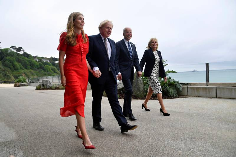 Britain's Prime Minister Boris Johnson, his wife Carrie Johnson and U.S. President Joe Biden with first lady Jill Biden walk outside Carbis Bay Hotel, Carbis Bay, Cornwall, Britain, ahead of the G7 summit, Thursday June 10, 2021. (Toby Melville/Pool Photo via AP)
