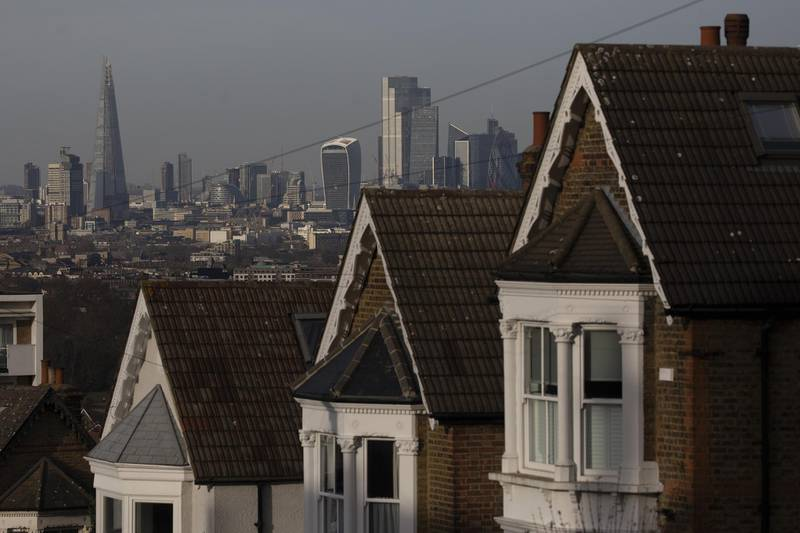 A terrace of residential houses in the Dulwich district in view of skyscrapers in the City of London, U.K., on Tuesday, Nov. 24, 2020. Asking prices for U.K. homes slipped this month as owners sought to get sales agreed in time to benefit from a temporary tax cut. Photographer: Simon Dawson/Bloomberg Photographer: Simon Dawson/Bloomberg