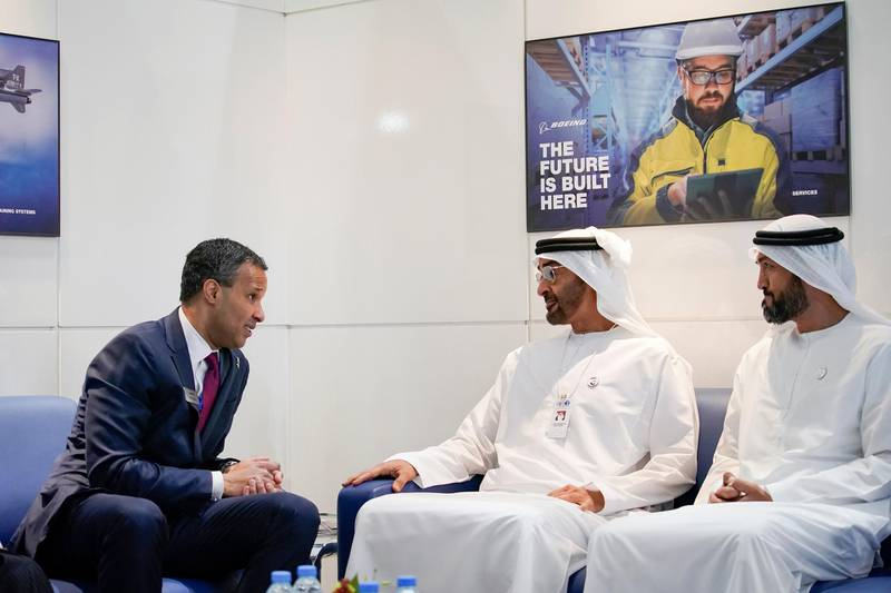 ABU DHABI, UNITED ARAB EMIRATES - February 18, 2019: HH Sheikh Mohamed bin Zayed Al Nahyan, Crown Prince of Abu Dhabi and Deputy Supreme Commander of the UAE Armed Forces (C) meets with Marc Allen, President of Boeing International (L), during the 2019 International Defence Exhibition and Conference (IDEX), at Abu Dhabi National Exhibition Centre (ADNEC). Seen with HE Mohamed Mubarak Al Mazrouei, Undersecretary of the Crown Prince Court of Abu Dhabi (R).  ( Ryan Carter / Ministry of Presidential Affairs ) ---