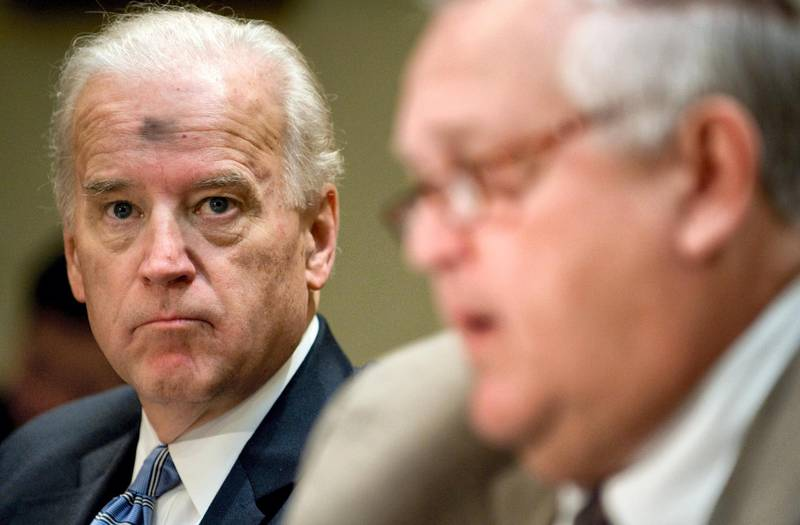 US Vice President Joe Biden listens as Chairman of the Transparency and Accountability Board, Earl Devaney (R) speaks during a Recovery Plan Implementation meeting in the Roosevelt Room of the White House in Washington, DC on February 25, 2009. (Editor note,the mark on Biden's head is from Christian worship services ashes from the first day of Lent).  AFP PHOTO / Saul LOEB (Photo by SAUL LOEB / AFP)