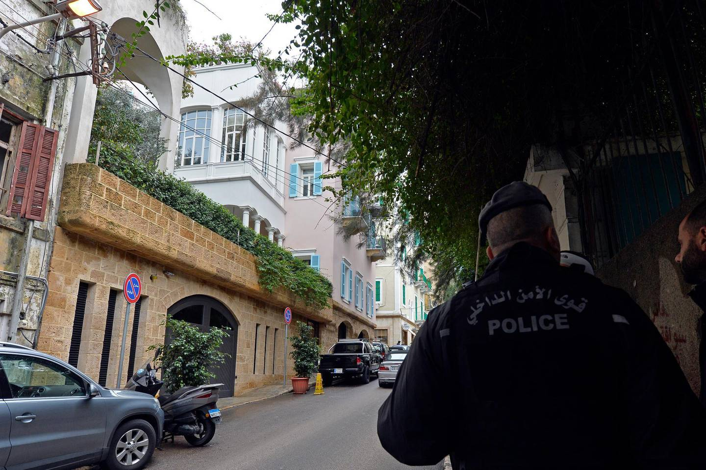 epa08095758 A Lebanese policeman stands guards in front of a house identified by court documents as belonging to former Nissan Motor Co. and Renault SA chairman Carlos Ghosn at the Ashrafieh area in Beirut, Lebanon, 31 December 2019. According to media reports, former Nissan chairman Carlos Ghosn, who was on bail and under surveillance in Tokyo awaiting trial on financial misconduct charges, has arrived in Beirut after he flew in on a private jet via Turkey on 30 December 2019.  EPA/WAEL HAMZEH