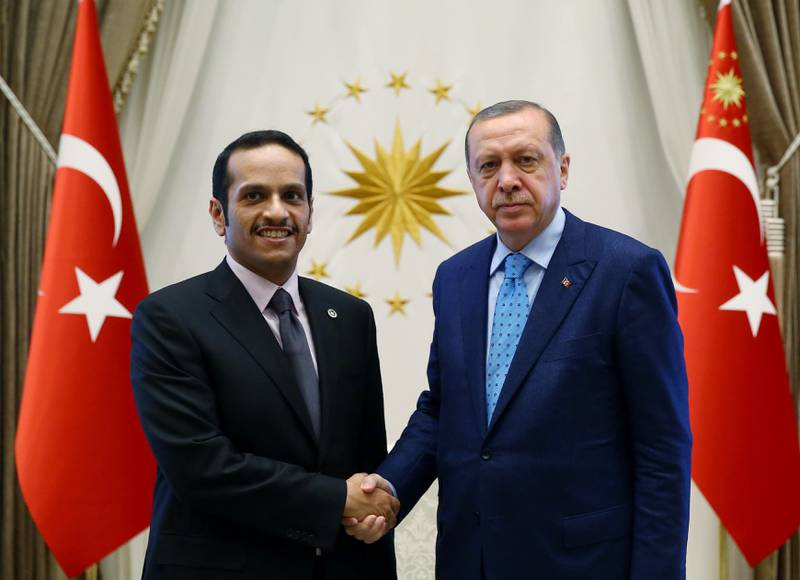 Turkey's President Recep Tayyip Erdogan, right, shakes hands with Qatar's Foreign Minister Sheikh Mohammed bin Abdulrahman Al Thani prior to their meeting in Ankara, Friday, July 14, 2017. Al Thani told reporters in Ankara Friday that Qatar would continue to work with the United States and Kuwait to end the standoff with its four Arab neighbours.(Presidency Press Service/Pool Photo via AP)