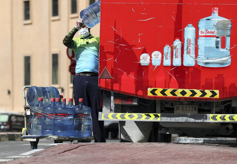 Dubai, United Arab Emirates - Reporter: N/A: A delivery driver stacks water to provide to residents in an extremely quiet Jumeirah Beach Residence. Wednesday, April 1st, 2020. Dubai. Chris Whiteoak / The National