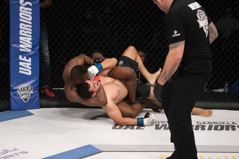 Emirati Rashed Dawood made a sensational MMA debut. Here he is seen with a rear naked choke on Uzbek Otabek Kadirov. Courtesy Palms Sports