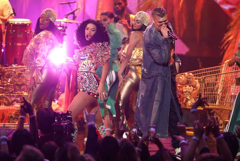 """Cardi B, left, and Bad Bunny perform """"I Like It"""" at the American Music Awards on Tuesday, Oct. 9, 2018, at the Microsoft Theater in Los Angeles. (Photo by Matt Sayles/Invision/AP)"""