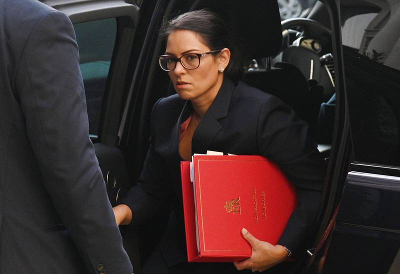 (FILES) In this file photo taken on September 22, 2020 Britain's Home Secretary Priti Patel arrives at the Foreign, Commonwealth and Development Office (FCDO) in central London on September 22, 2020 to attend the weekly meeting of the cabinet.  A Cabinet Office inquiry into allegations of bullying by Priti Patel has found evidence that she broke the ministerial code, informed sources said on November 20, 2020. / AFP / POOL / Leon Neal