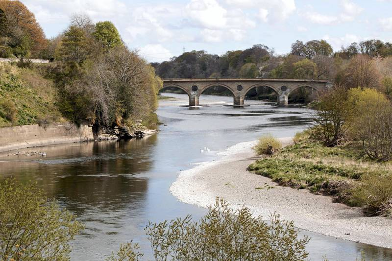 The River Tweed, which acts as the border between Scotland and England, and Coldstream Bridge. Photograph: Stuart Boulton