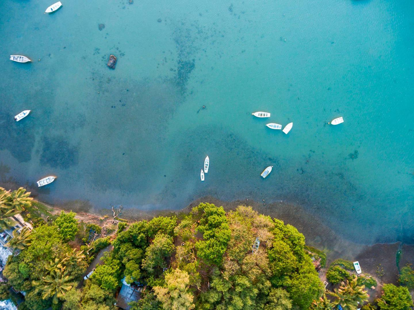 Mauritius, Riviere Noire, La Gaulette, Boats on the water, drone view. Getty Images