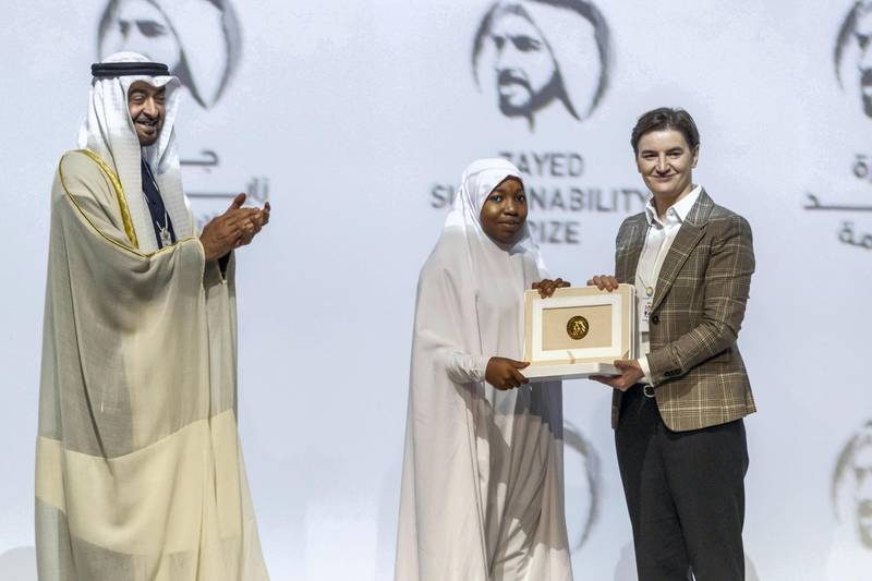 ABU DHABI, UNITED ARAB EMIRATES. 13 JANUARY 2020. The Zayed Sustainability Awards held at ADNEC as part of Abu Dhabi Sustainability Week. H.E. Sheikh Mohammed bin Zayed Al Nahyan, Crown Prince of Abu Dhabi and Deputy Supreme Commander of the United Arab Emirates Armed Forces awards Global High Schools Winner: Sub Sahara Africa, Hakimi Aliyu Day Secondary School, Nigeria with the Prime Minister of Serbia Ana Brnabić. (Photo: Antonie Robertson/The National) Journalist: Kelly Clarker. Section: National.