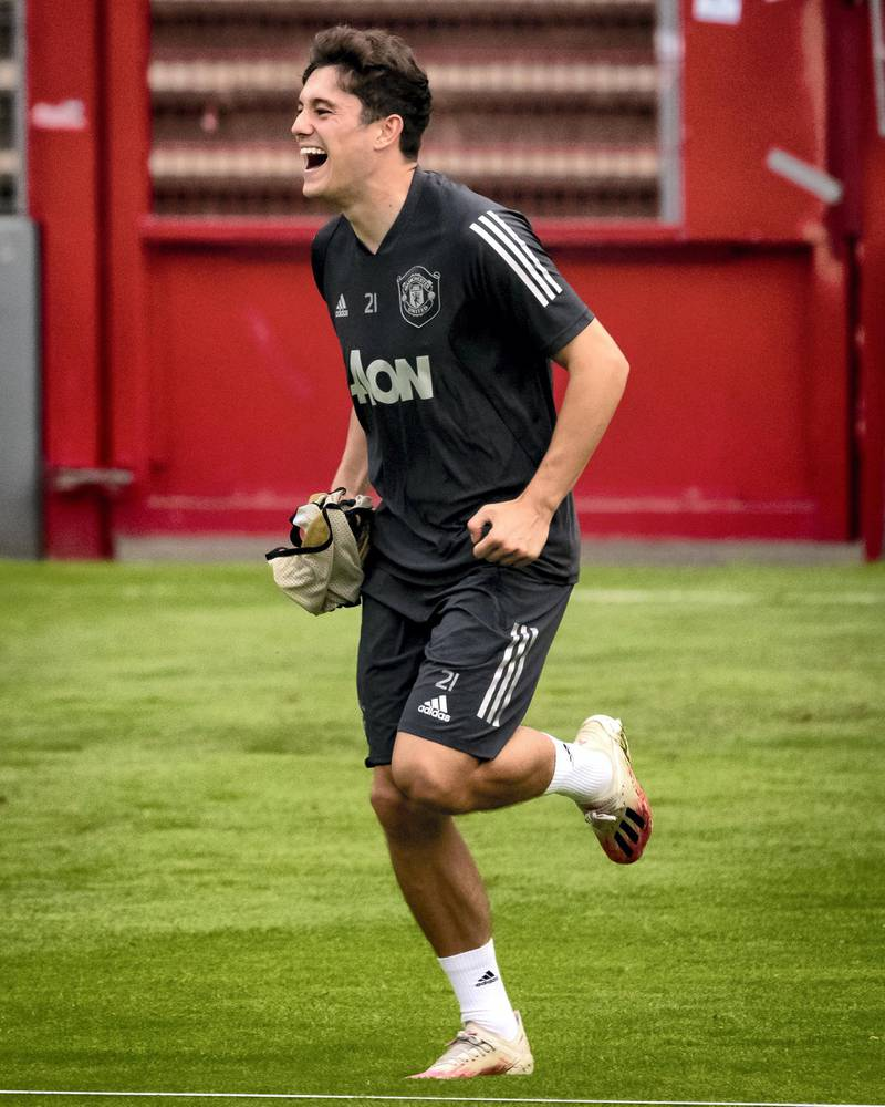 COLOGNE, GERMANY - AUGUST 15:  Daniel James of Manchester United  laughs during a training session at RheinEnergieStadion on August 15, 2020 in Cologne, Germany. (Photo by Ash Donelon/Manchester United via Getty Images)