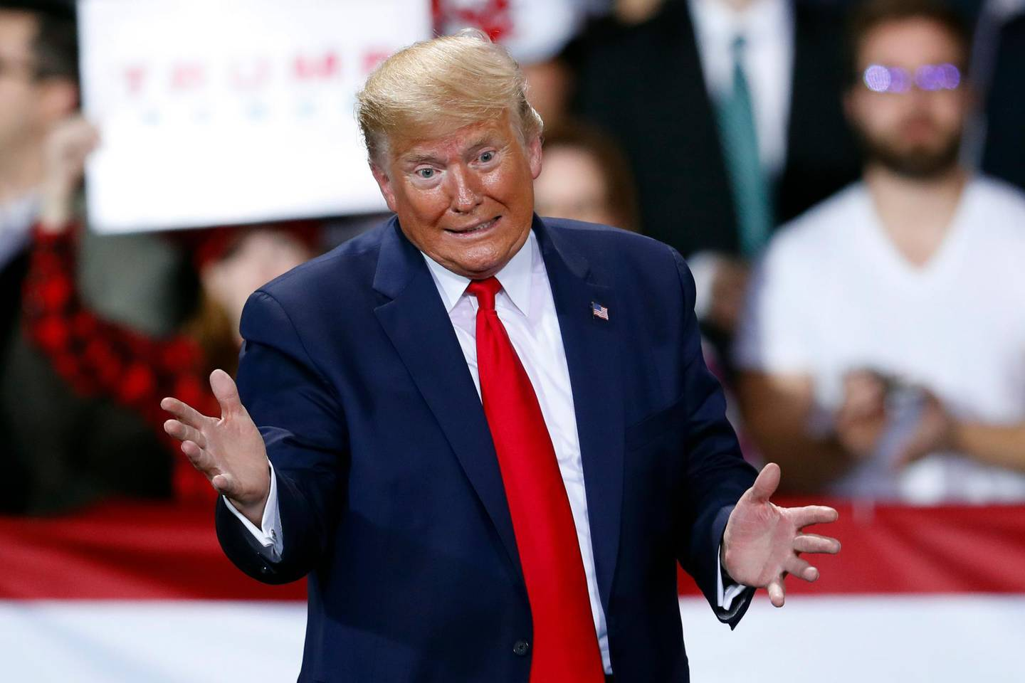 """In this Dec. 18, 2019, photo, President Donald Trump speaks at a campaign rally in Battle Creek, Mich. Using stark """"Us versus Them"""" language, Trump and his campaign are trying to frame impeachment not as judgment on his conduct but as a culture war referendum on him and his supporters, aiming to motivate his base heading into an election year (AP Photo/Paul Sancya)"""