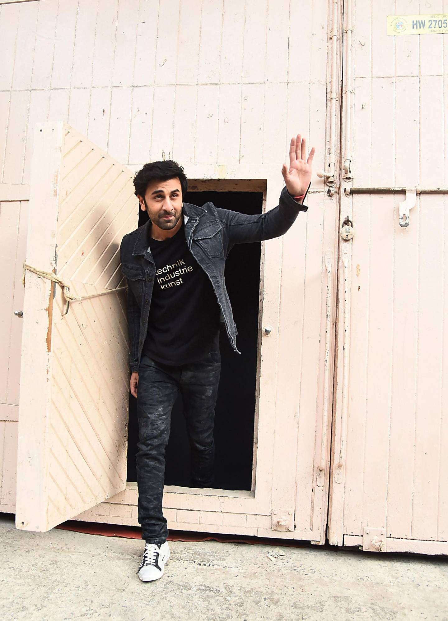 In this picture taken on June 27, 2018, Indian Bollywood actor Ranbir Kapoor poses for a picture during the promotion of the upcoming biographical Hindi film 'Sanju' in Mumbai. A Indian biopic out June 29 charts the troubled life of Bollywood star Sanjay Dutt, including his battles with drug addiction and jail time for keeping illegal weapons. / AFP / Sujit Jaiswal