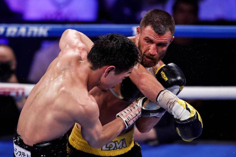 epa09304823 Vasiliy Lomachenko of Ukraine (R) in action against Masayoshi Nakatani of Japan during their 12 rounds lightweight fight at The Theater at Virgin Hotels in Las Vegas, Nevada, USA, 26 June 2021.  EPA/ETIENNE LAURENT