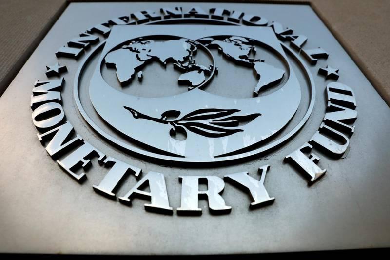 FILE PHOTO: The International Monetary Fund (IMF) logo is seen outside the headquarters building in Washington, U.S., as IMF Managing Director Christine Lagarde meets with Argentine Treasury Minister Nicolas Dujovne September 4, 2018. REUTERS/Yuri Gripas/File Photo