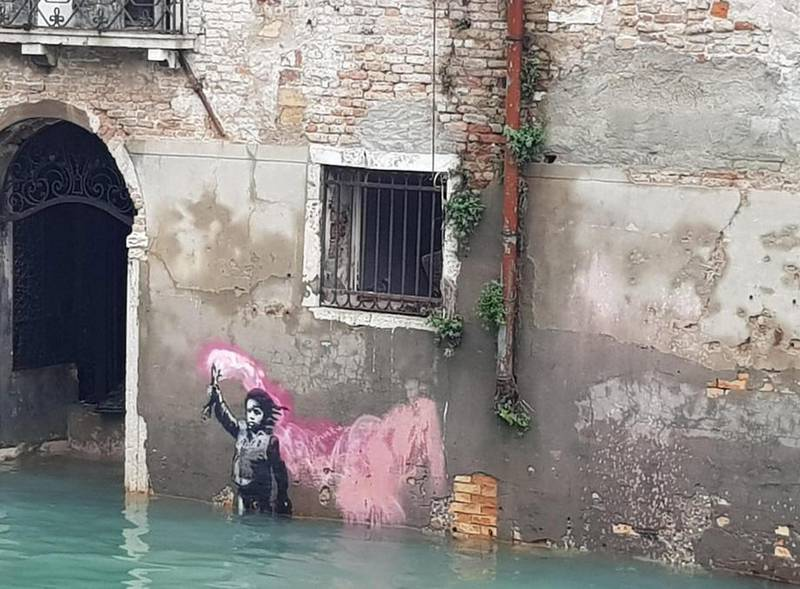 epa07992226 A view of Banksy's migrant child mural submerged in high water in Venice, northern Italy, 13 November 2019. A wave of bad weather has hit much of Italy on 12 November. Levels of 100-120cm above sea level are fairly common in the lagoon city and Venice is well-equipped to cope with its rafts of pontoon walkways.  EPA-EFE/ROSANNA CODINO -- BEST QUALITY AVAILABLE
