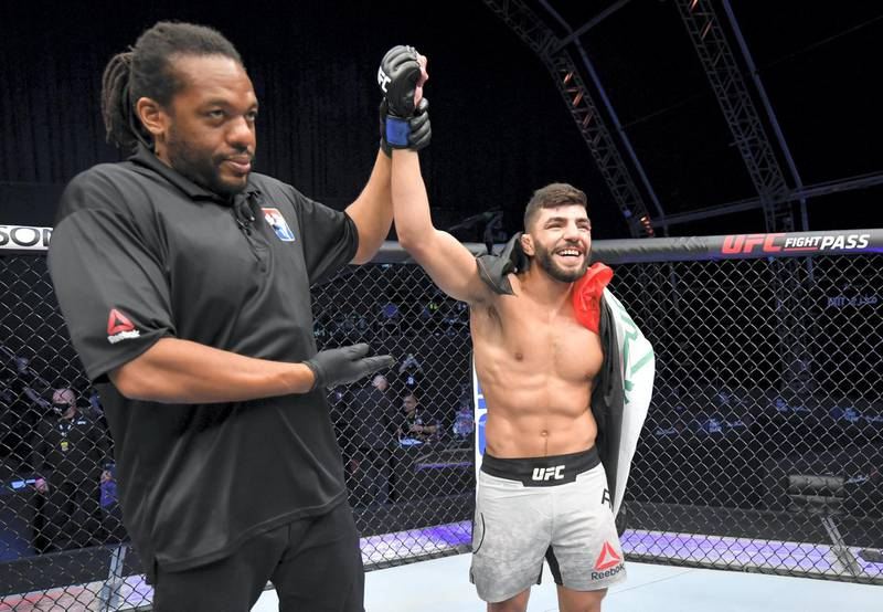 ABU DHABI, UNITED ARAB EMIRATES - JULY 19: Amir Albazi of Iraq celebrates after his submission victory over Malcolm Gordon of Canada in their bantamweight bout during the UFC Fight Night event inside Flash Forum on UFC Fight Island on July 19, 2020 in Yas Island, Abu Dhabi, United Arab Emirates. (Photo by Jeff Bottari/Zuffa LLC via Getty Images) *** Local Caption *** ABU DHABI, UNITED ARAB EMIRATES - JULY 19: Amir Albazi of Iraq celebrates after his submission victory over Malcolm Gordon of Canada in their bantamweight bout during the UFC Fight Night event inside Flash Forum on UFC Fight Island on July 19, 2020 in Yas Island, Abu Dhabi, United Arab Emirates. (Photo by Jeff Bottari/Zuffa LLC via Getty Images)