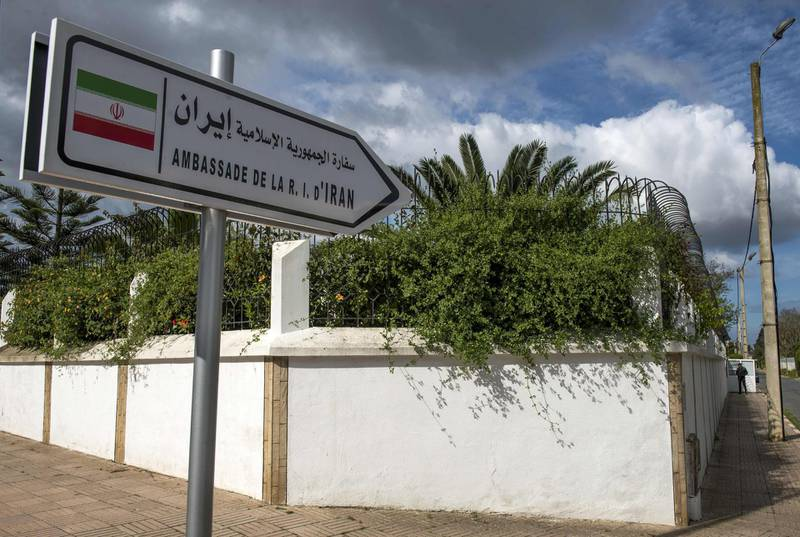 A sign indicating the way to the embassy of Iran in Rabat is seen on May 2, 2018. Iran today denied that it was involved in a weapons delivery to the Polisario Front movement seeking independence for Western Sahara, after Morocco cut diplomatic ties with Tehran over the allegations. Morocco, which has close relations with Iran's regional rival Saudi Arabia, on Tuesday accused Tehran of using its Lebanese militia ally Hezbollah to deliver weapons to the Polisario Front.  / AFP PHOTO / FADEL SENNA
