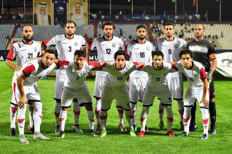 Yemen's national team football players pose for a group photo ahead of their 2017 Gulf Cup of Nations football match between Qatar and Yemen at the Sheikh Jaber al-Ahmad Stadium in Kuwait City on December 23, 2017. (Photo by GIUSEPPE CACACE / AFP)