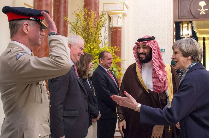 """A handout picture provided by the Saudi Royal Palace on April 4, 2017 shows Saudi Deputy Crown Prince Mohammed bin Salman (2nd L), the kingdom's defence minister, and British Prime Minister Theresa May (R) greeting officials in the capital Riyadh. / AFP PHOTO / Saudi Royal Palace / BANDAR AL-JALOUD / RESTRICTED TO EDITORIAL USE - MANDATORY CREDIT """"AFP PHOTO / SAUDI ROYAL PALACE / BANDAR AL-JALOUD"""" - NO MARKETING - NO ADVERTISING CAMPAIGNS - DISTRIBUTED AS A SERVICE TO CLIENTS"""