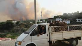 Turkey's Erdogan under pressure as wildfires rip through towns and forests