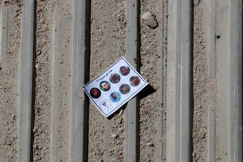 """One of the warning leaflets dropped by the Syrian army is seen in the rebel held Tariq al-Bab neighbourhood of Aleppo, Syria September 25, 2016. The leaflet reads (top) """"This is your destiny!!!"""" and (bottom L) """" who is next"""" as it depicts pictures of killed rebel commanders and fighters. REUTERS/Abdalrhman Ismail      TPX IMAGES OF THE DAY"""