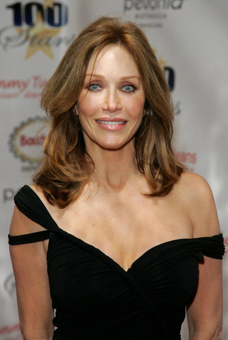 """(FILES) In this file photo actress Tanya Roberts arrives at the 18th Annual Night Of 100 Stars Gala held at the Beverly Hills Hotel on February 24, 2008 in Beverly Hills, California.   Former Bond actress and """"That '70s Show"""" star Tanya Roberts has died in Los Angeles at the age of 65, media reports said. Roberts, who had been hospitalized since December 24, 2020 after she collapsed while walking her dogs, died on January 3, 2021, her publicist Mike Pingel told The Hollywood Reporter.""""I'm devastated. She was brilliant and beautiful and I feel like a light has been taken away. To say she was an angel would be at the top of the list,"""" he said.  / AFP / GETTY IMAGES NORTH AMERICA / Neilson Barnard"""