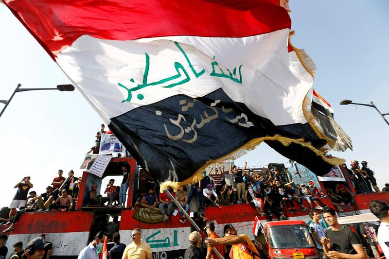 Iraqi demonstrators gather to mark the first anniversary of the anti-government protests in Baghdad, Iraq October 25, 2020. REUTERS/Thaier Al-Sudani