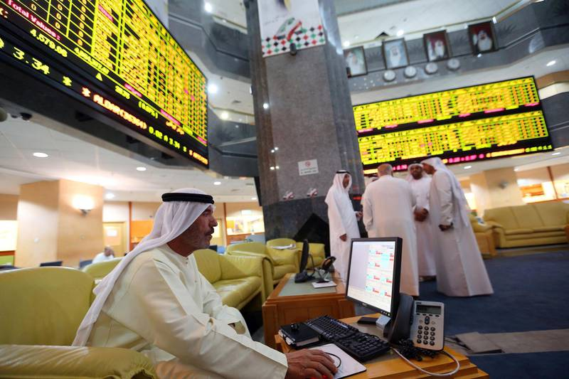 An investor monitors a screen displaying stock information at the Abu Dhabi Securities Exchange June 25, 2014. The spectacular rise and fall of Arabtec, Dubai's most heavily traded stock, teaches hard lessons about how risky the region remains for investors even as its rapid economic growth lures billions of dollars in fresh funds from abroad. Wild trading by local retail investors who dominate activity, plus weak corporate disclosure and a hands-off approach by regulators, can make a toxic mix, and on occasion destabilise entire markets.  REUTERS/Stringer  (UNITED ARAB EMIRATES - Tags: BUSINESS) - GM1EA6P1SB001