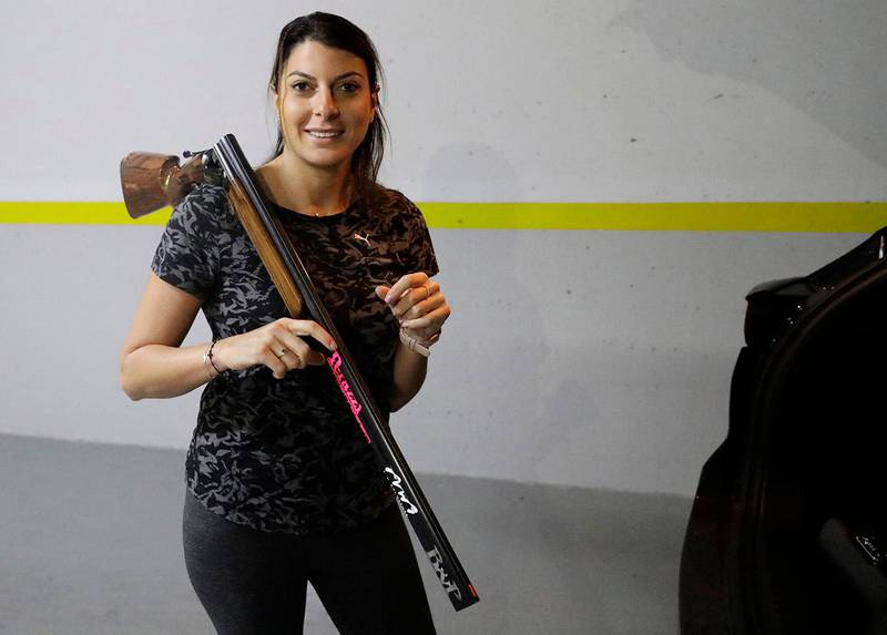 Lebanese trap shooter Ray Bassil is pictured during a training session for this summer's Olympics in her underground parking in Sahel Alma near the coastal city of Jounieh, north of the capital Beirut, on February 5, 2021. - Determined to stay fit despite the coronavirus pandemic, the 32-year-old turned the parking spaces under her apartment block into a virtual firing range, all without shooting a single round.Bassil herself had fallen ill from Covid-19, but sprang back into training despite the round-the-clock curfew. (Photo by JOSEPH EID / AFP)