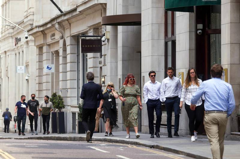 Workers pass along a street in the City of London, U.K., on Monday, June 7, 2021. Three lockdowns have left the U.K.'s financial center transformed. Photographer: Chris Ratcliffe/Bloomberg