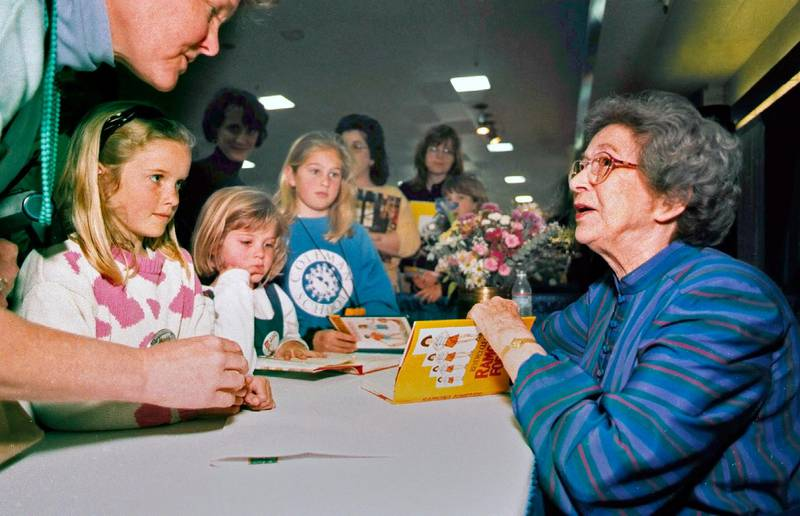 FILE - In this April 19, 1998 file photo, Beverly Cleary signs books at the Monterey Bay Book Festival in Monterey, Calif. The beloved children's author, whose characters Ramona Quimby and Henry Huggins enthralled generations of youngsters, has died. She was 104. Cleary's publisher, HarperCollins, announced her death Friday, March 26, 2021. In a statement, the company said Cleary died in Carmel, California, her home since the 1960s, on Thursday. No cause of death was given. (Vern Fisher/The Monterey County Herald via AP, File)