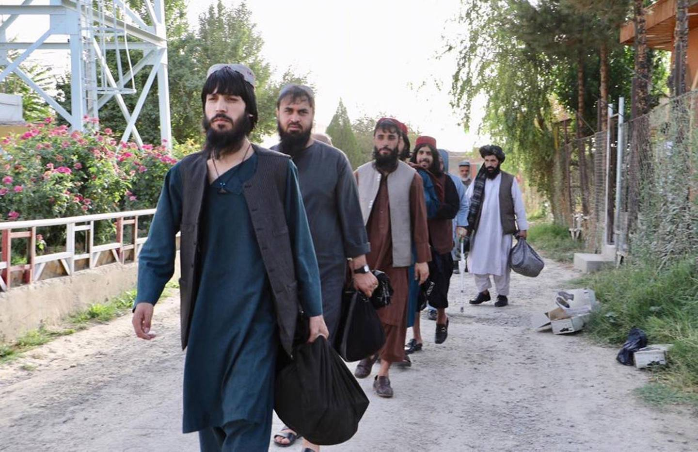 epa08602640 A handout photo made available by the National Security Council (NSC) of Afghanistan shows Taliban prisoners preparing to leave from a government prison in Kabul, Afghanistan, 13 August 2020 (issued 14 August 2020). Afghanistan's National Security Council announced that at least 80 Taliban prisoners out of 400 have been released from jail. The prisoners' release is a pre-condition for the intra-Afghan talks.  EPA/AFGHANISTAN NATIONAL SECURITY COUNCIL HANDOUT -- BEST QUALITY AVAILABLE -- HANDOUT EDITORIAL USE ONLY/NO SALES