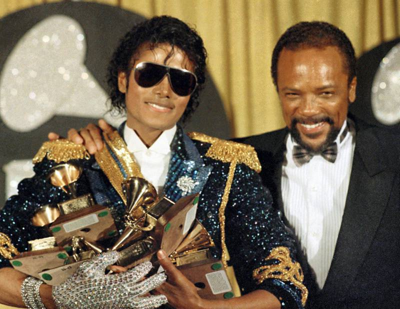 """FILE - In this Feb. 28, 1984 file photo, Michael Jackson, left, holds eight awards as he poses with Quincy Jones at the Grammy Awards in Los Angeles. On Wednesday, July 26, 2017, a jury found that Jackson's estate owes Jones $9.4 million in royalties and production fees from """"Billie Jean,"""" """"Thriller"""" and more of the superstar's  biggest hits. (AP Photo/Doug Pizac, File)"""