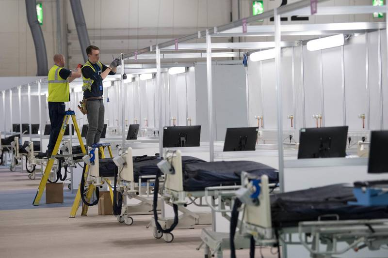 LONDON, ENGLAND - MARCH 31: Work continues at the ExCel centre which is being made into the temporary NHS Nightingale hospital, comprising of two wards, each of 2,000 people, to help tackle coronavirus on March 31, 2020 in London, England. The Coronavirus (COVID-19) pandemic has spread to many countries across the world, claiming over 41,000 lives and infecting hundreds of thousands more. (Photo by Stefan Rousseau - WPA Pool/Getty Images)