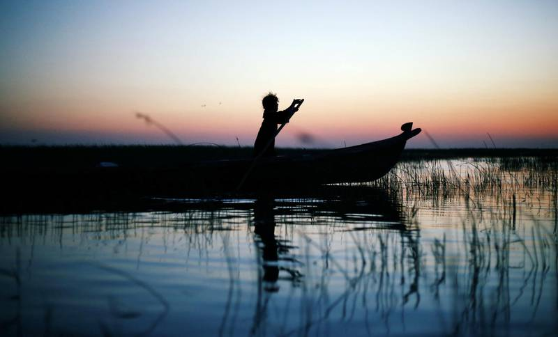 An Iraqi Marsh Arab girl paddles her boat at the Chebayesh marsh in Dhi Qar province, Iraq April 13, 2019.  Picture taken April 13, 2019. REUTERS/Thaier al-Sudani