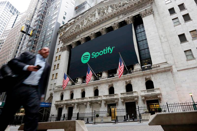 A Spotify banner adorns the facade of the New York Stock Exchange, Tuesday, April 3, 2018. Spotify, the No. 1 music streaming service which has drawn comparisons to Netflix, is about to find out how it plays on the stock market in an unusual IPO. (AP Photo/Richard Drew)