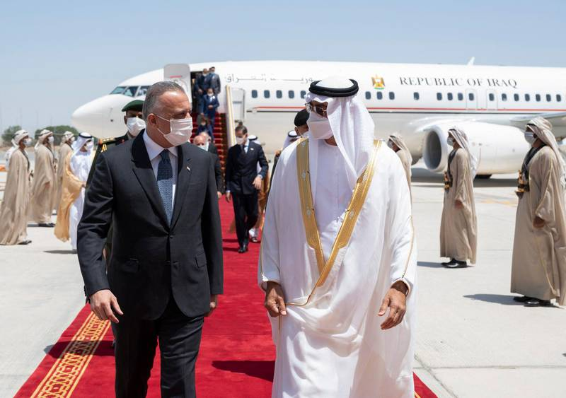 """A handout image provided by United Arab Emirates News Agency (WAM) on April 4, 2021 shows Sheikh Mohamed bin Zayed al-Nahyan (R), Crown Prince of Abu Dhabi and Deputy Supreme Commander of the UAE Armed Forces, welcoming Iraq's Prime Minister Mustafa al-Kadhemi upon his arrival in Abu Dhabi.  - === RESTRICTED TO EDITORIAL USE - MANDATORY CREDIT """"AFP PHOTO / HO / WAM"""" - NO MARKETING NO ADVERTISING CAMPAIGNS - DISTRIBUTED AS A SERVICE TO CLIENTS ===  / AFP / WAM / - / === RESTRICTED TO EDITORIAL USE - MANDATORY CREDIT """"AFP PHOTO / HO / WAM"""" - NO MARKETING NO ADVERTISING CAMPAIGNS - DISTRIBUTED AS A SERVICE TO CLIENTS ==="""