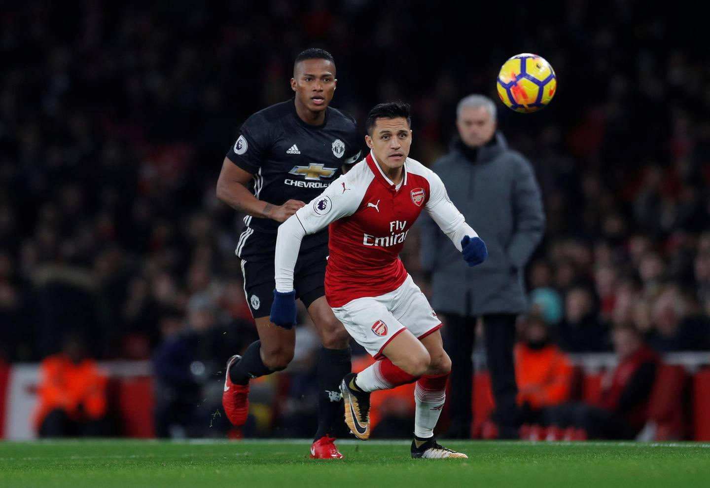 """Soccer Football - Premier League - Arsenal vs Manchester United - Emirates Stadium, London, Britain - December 2, 2017   Arsenal's Alexis Sanchez in action with Manchester United's Antonio Valencia    Action Images via Reuters/Andrew Couldridge    EDITORIAL USE ONLY. No use with unauthorized audio, video, data, fixture lists, club/league logos or """"live"""" services. Online in-match use limited to 75 images, no video emulation. No use in betting, games or single club/league/player publications. Please contact your account representative for further details."""