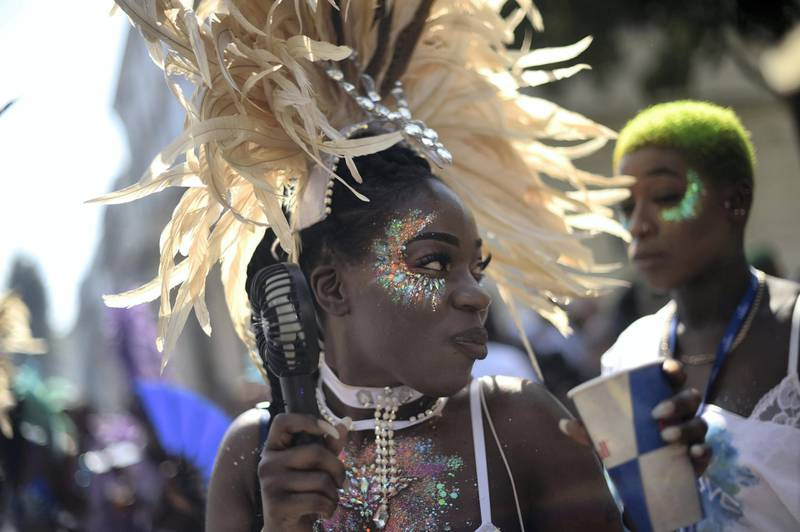 """LONDON, ENGLAND - AUGUST 25: Revellers and paraders attend the Notting Hill carnival on August 25, 2019 in London, England. One million people are expected on the streets in scorching temperatures for the Notting Hill Carnival. The Metropolitan Police have a large security operation in place, including """"significantly more"""" knife arches than last year, to deliver what they hope will be a """"safe and spectacular"""" festival. (Photo by Peter Summers/Getty Images)"""
