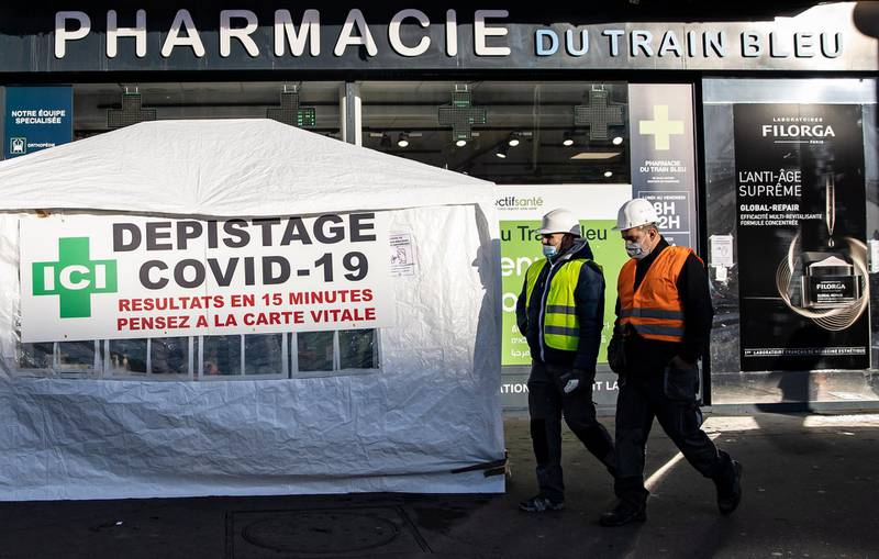 epa08800005 Pedestrians pass by a COVID-19 test center set up outside a pharmacy, in Paris, France, 05 November 2020. France is placed in a second national lockdown, dubbed 'reconfinement' to battle a surge in Covid-19 coronavirus cases, averaging 40,000 new daily cases.  EPA/IAN LANGSDON