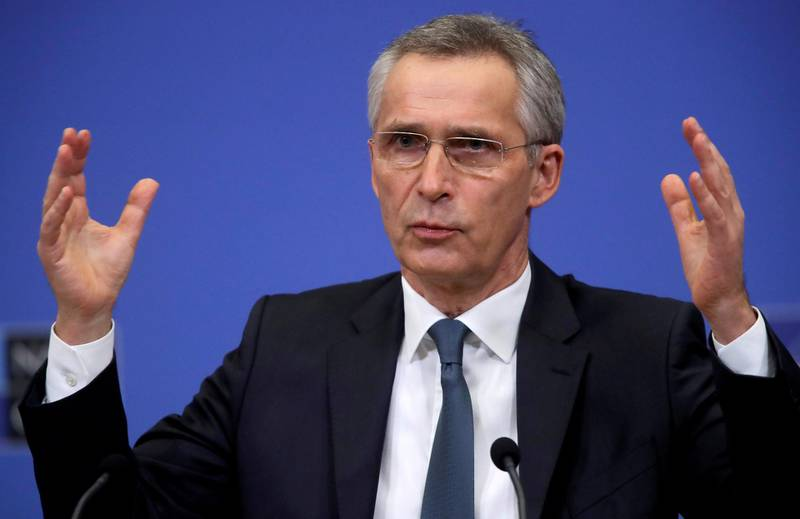 FILE PHOTO: NATO Secretary General Jens Stoltenberg gestures during a news conference ahead of a NATO defence ministers council at the alliance headquarters in Brussels, Belgium February 15, 2021. Olivier Hoslet/Pool via REUTERS/File Photo